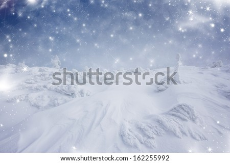 Christmas background with stars and footsteps in the snow  - stock photo