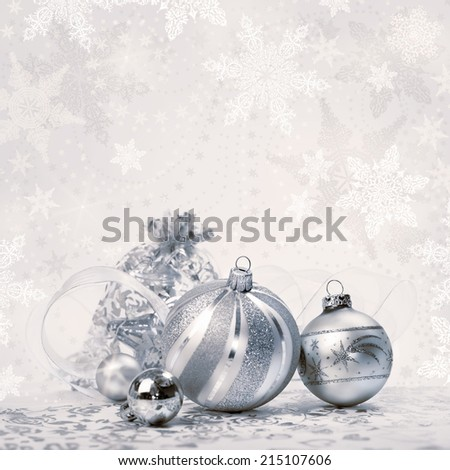 Christmas background with trinkets and snowflakes; text space; shallow DOF, focus on the small ball. - stock photo
