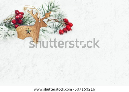 christmas background with wooden reindeer