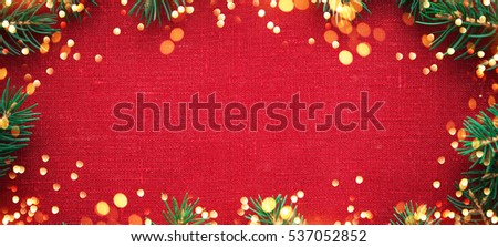 Christmas background with xmas tree and sparkle bokeh lights on red canvas background. Merry christmas greeting card, banner, frame. Winter holiday theme. Happy New Year. Space for text.