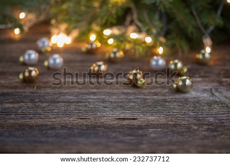 christmas background  - wooden table with defocused lights and decorationd - stock photo