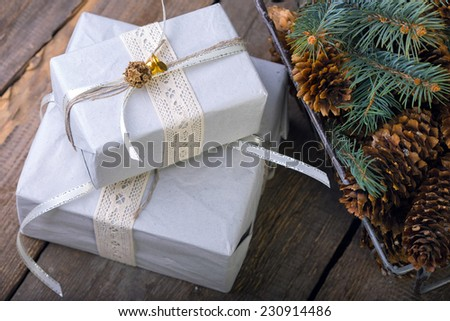 Christmas backgrounds. Gifts and Christmas decor on the wooden background.
