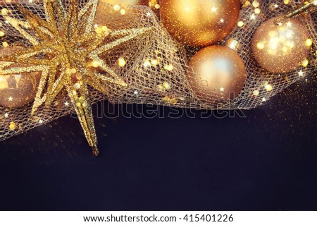 Christmas backround. Fir branch with golden decorations. - stock photo