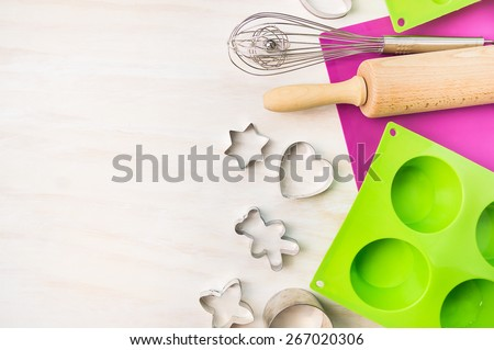 Christmas bake tools for cookie and cake mould for muffin and cupcake on white wooden background, top view,place for text - stock photo