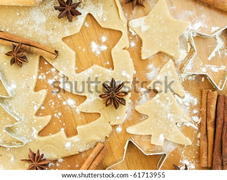 Christmas baking background: dough, cookie cutters and spices. Viewed from above. - stock photo