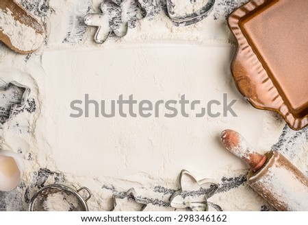 Christmas baking background with flour, rolling pin, cookie cutter and  rustic bake pan, top view, place for text. Horizontal - stock photo