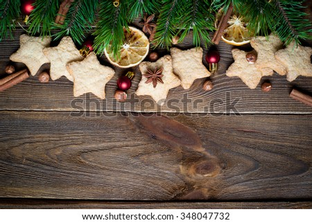Christmas baking concept -  some cookies, fir tree brunches and decorations. Top view, copy space - stock photo