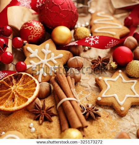 christmas baking ingredients - christmas gingerbread cookies, spices, nuts and fruits - stock photo