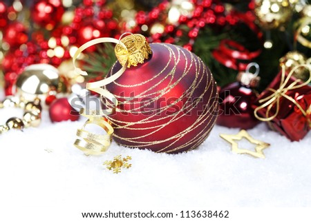 Christmas ball and Christmas tree with decorations - stock photo