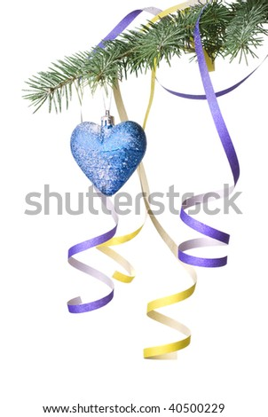Christmas ball and decoration on fir tree branch isolated on white