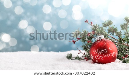 Christmas ball and fir branch on abstract background - stock photo