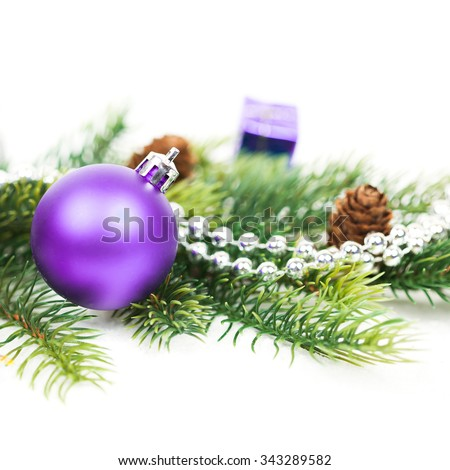Christmas ball and fir branches with decorations isolated over white - stock photo