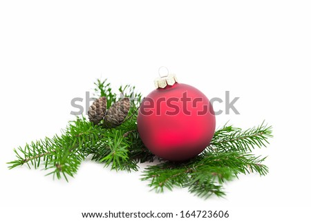 Christmas ball and green spruce branch on white background - stock photo