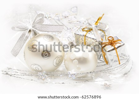 Christmas ball baubles with gifts and silver decoration - stock photo