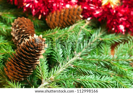 Christmas ball (heart) on the fir branch background - stock photo
