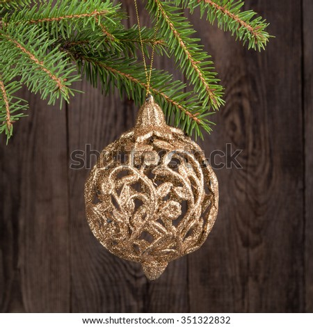 Christmas ball on fir branches on the background of old boards. - stock photo