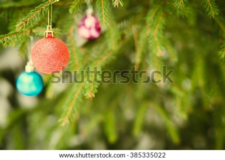 Christmas ball on fir-tree branch outdoor - stock photo