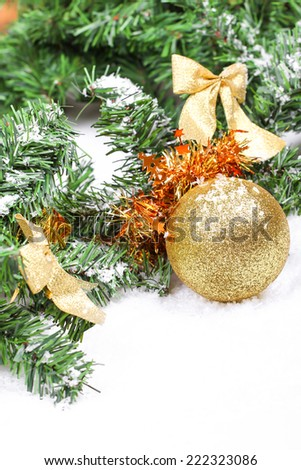 Christmas ball on new year tree branch in snow