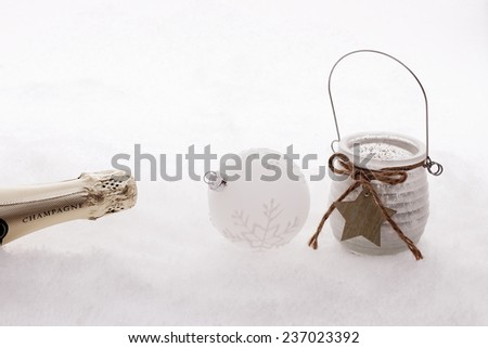 Christmas ball,  wind candle, champagne bottle in snow, white edition - stock photo