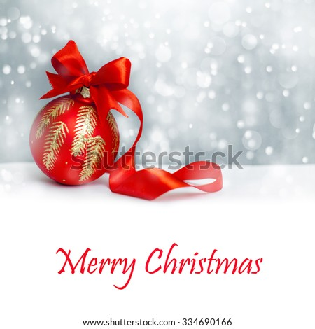 Christmas ball with red bow and ribbon - stock photo