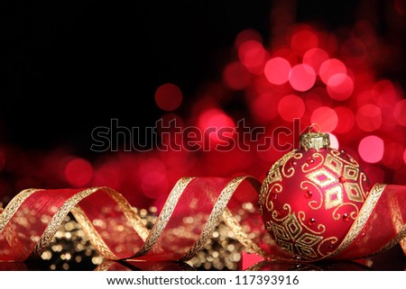 Christmas ball with ribbon on abstract light background,Shallow Dof. - stock photo