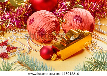 Christmas balls and decorations on golden background - stock photo