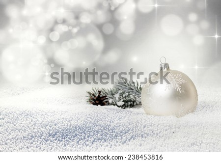Christmas balls and fir branch in snow on bokeh background  - stock photo