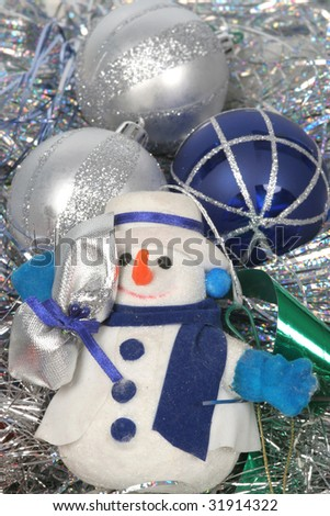 Christmas balls and Snow man on silver background
