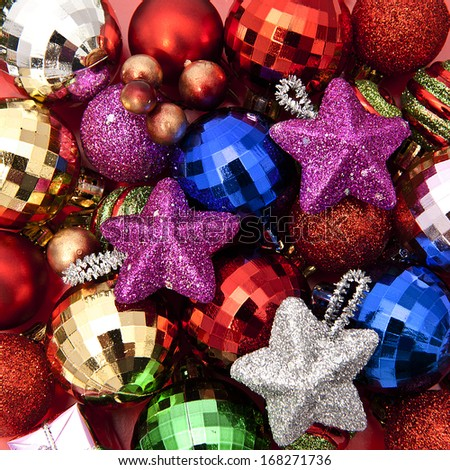 Christmas balls and stars colorful background