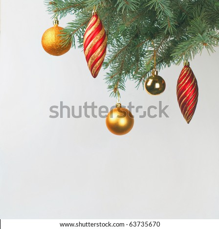 Christmas balls decoration on a new-year tree on white background