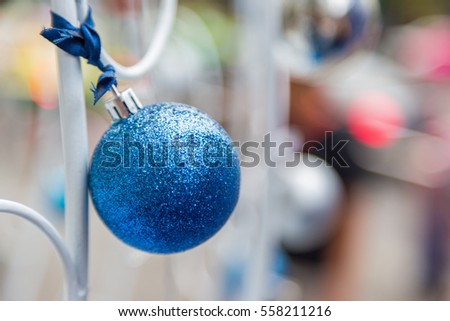 Christmas balls hanging on ribbon with bokeh background