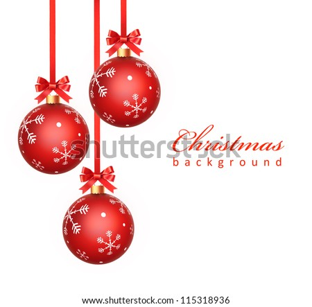 Christmas balls hanging with ribbon bows and snowflakes on white background - stock photo