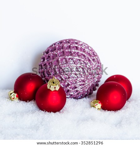 christmas balls in snow -  isolated
