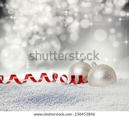 Christmas balls in snow on bokeh background  - stock photo