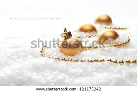 Christmas balls in the snow - stock photo