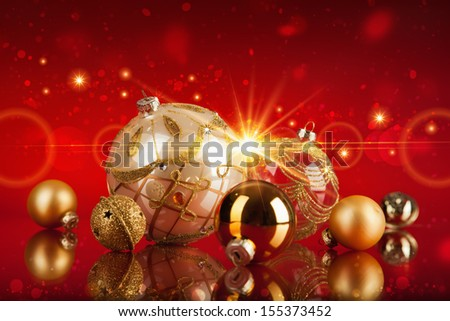 Christmas balls in the sun on a red background