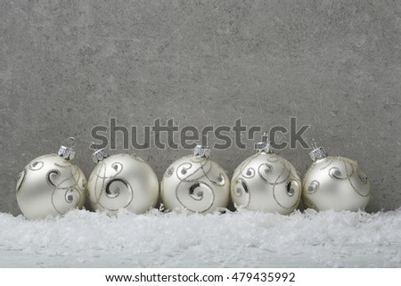 Christmas balls on concrete background, close-up