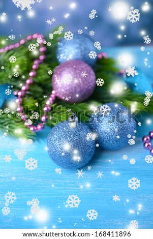 Christmas balls on fir tree, on color background