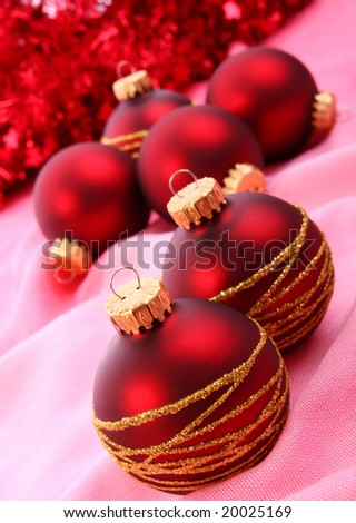 Christmas balls on pink background