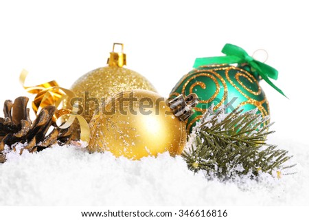 Christmas balls on snow with white background