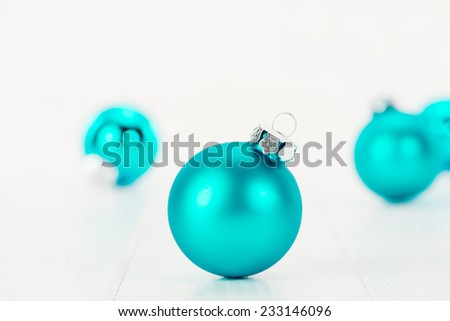 Christmas balls on white wooden table