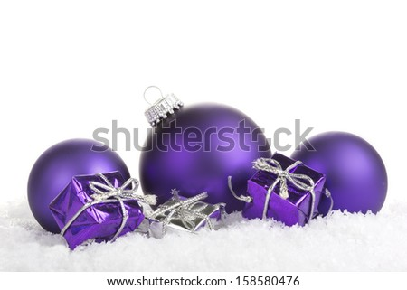 Christmas balls purple with presents on white background  - stock photo