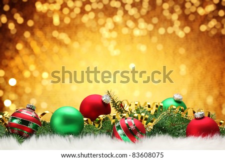 Christmas balls with pine branch on festive background. - stock photo