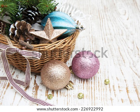 Christmas basket with toys on a wooden  background - stock photo