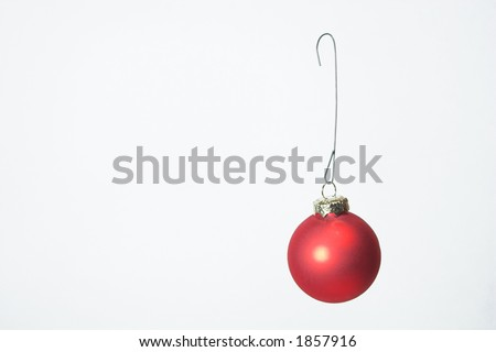 "Christmas baubel. This image has a personal ""hands on"" feel to it with the wire hook."