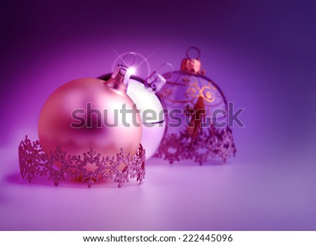 christmas bauble and decorative stripes on violet background - stock photo