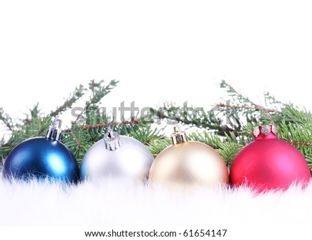 Christmas bauble and pine branch on white background