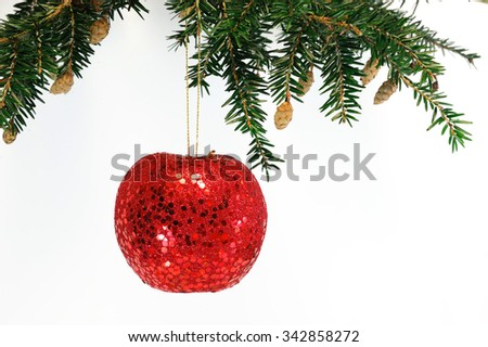 Christmas bauble apple hanging on pine branch - stock photo