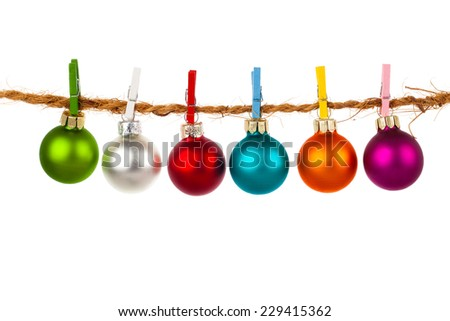 Christmas bauble collection hang on rope, isolated on white background - stock photo
