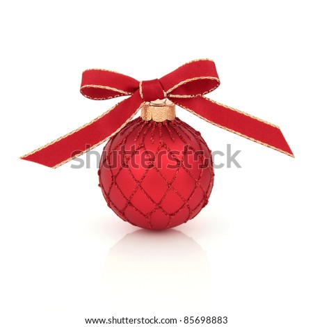 Christmas bauble decoration with red and gold ribbon and bow, isolated over white background.
